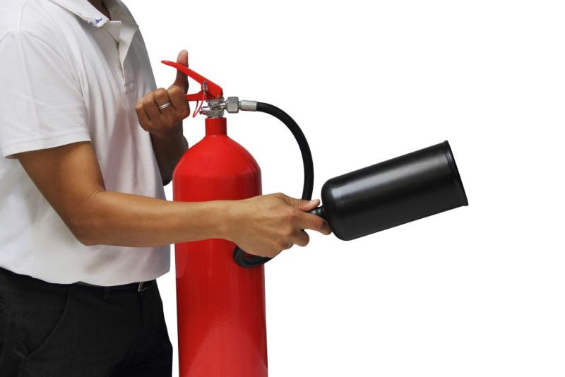 Man showing how to use fire extinguisher isolated over white